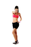 Young happy sport woman pointing Royalty Free Stock Image