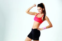 Young happy sport woman showing her biceps Royalty Free Stock Photo