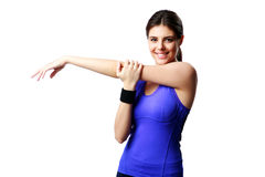Young happy sport woman stretching hands Royalty Free Stock Images