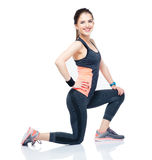 Young happy sporty woman stretching Stock Photo