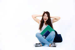 Young happy student. Student with backpack and books on white background Stock Photography