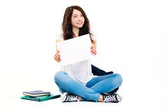 Young happy student. Student with backpack and books on white background Royalty Free Stock Photography