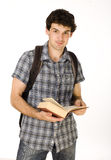 Young happy student carrying bag and book Royalty Free Stock Photography