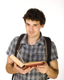 Young happy student carrying bag and books Stock Photos