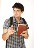 Young happy student carrying bag and books. Isolated Royalty Free Stock Photos