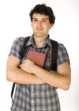 Young happy student carrying bag and books Royalty Free Stock Photo