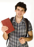 Young happy student carrying bag and books Royalty Free Stock Image