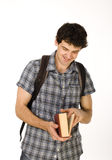 Young happy student carrying bag and books. Isolated Royalty Free Stock Image