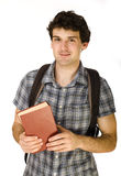Young happy student carrying bag and books. Isolated Stock Photography