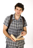 Young happy student carrying bag and books Royalty Free Stock Photos