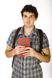 Young happy student carrying bag and books Stock Photography