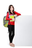 Young happy student carrying books with copyspace Royalty Free Stock Photos