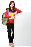 Young happy student carrying books with copyspace Royalty Free Stock Photo