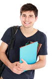 Young happy student carrying books. Portrait of Young happy student carrying bags and books Royalty Free Stock Photo