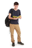 Young happy student carrying books. Portrait of Young happy student carrying bags and books Royalty Free Stock Photography