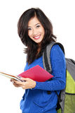 Young happy student carrying books Royalty Free Stock Photos