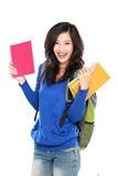 Young happy student carrying books Stock Photo