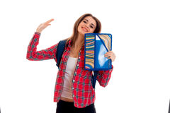 Young happy student girl with folders for notebooks posing isolated on white background in studio Royalty Free Stock Photo
