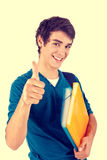 Young happy student showing thumbs up royalty free stock images