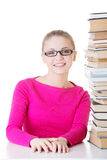 Young happy student with stack of books. Royalty Free Stock Photos