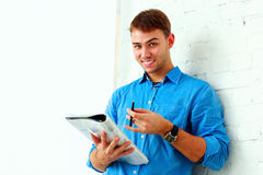 Young happy student standing with folder Royalty Free Stock Photo