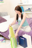 Young happy student unpack shopping bags Royalty Free Stock Photography