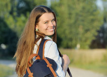 Young happy student walking with bag in the park Royalty Free Stock Photography