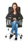 Young happy student woman sitting on a wheel chair Royalty Free Stock Images