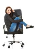 Young happy student woman sitting on a wheel chair Stock Photos