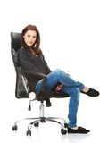 Young happy student woman sitting on a wheel chair Royalty Free Stock Photo