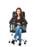 Young happy student woman sitting on a wheel chair Royalty Free Stock Image