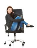 Young happy student woman sitting on a wheel chair Royalty Free Stock Photography