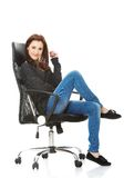 Young happy student woman sitting on a wheel chair Stock Images
