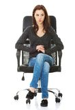 Young happy student woman sitting on a wheel chair Stock Photo
