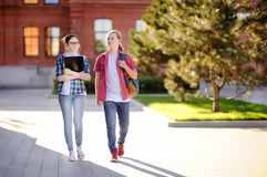 Young happy students with books and notes in University campus Stock Photo