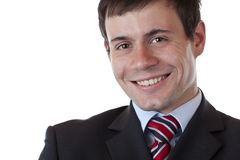 Young happy successful businessman looks at camera Stock Images