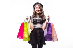 Young happy summer shopping woman with shopping bags isolated on white background. Young happy summer shopping woman with shopping bags Stock Photography