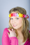 Young happy summer woman with funny flower band Stock Photos