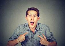 Young happy surprised man pointing at himself you mean me Royalty Free Stock Images