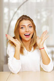 Young happy surprised woman Royalty Free Stock Photos