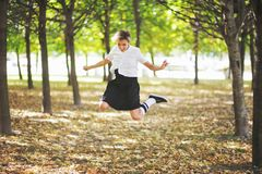 Young happy teen girl jumping outdoors. Motion blur Stock Photography