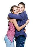 Young happy teen smiling couple. White background. Strong embraces stock photo