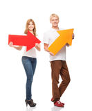 Young and happy teenage couple holding arrows Royalty Free Stock Photo