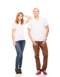 Young and happy teenage couple in stylish clothes on white Stock Photo