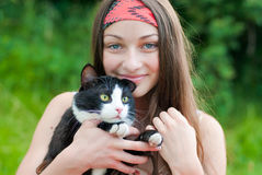 Young happy teenage girl holding cat royalty free stock photography