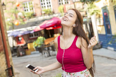 Young happy teenage girl in urban place Stock Photo