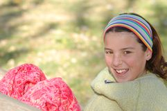 Young happy teenager. A teenager girl having a good time in the park Stock Photography