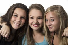 Young Happy Teenager Girls hugging each other Stock Photos