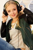 Young happy teenager is wearing headphones Stock Photography