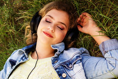 Young happy teenager is wearing headphones Royalty Free Stock Images